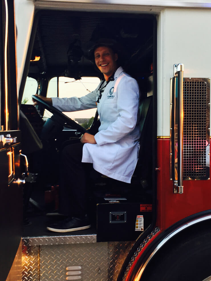 Dr. Rorick in a fire truck